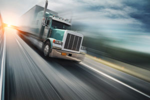 Teal Freight Truck In Motion