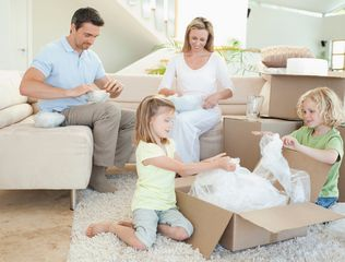 picture of family unpacking boxes